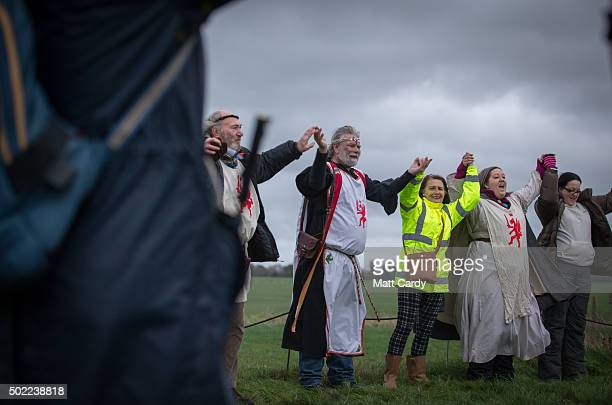 Arthur Pendragon leads a ceremony as druids pagans and revellers gather at Stonehenge hoping to see the sun rise as they take part in a winter...
