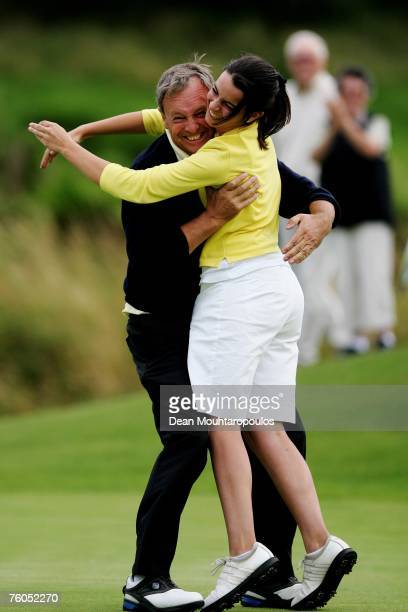 Arthur Pierse from Tipperary a former Walker Cup player celebrates with his daughter and caddy Jill after what he thought was the winning putt in the...