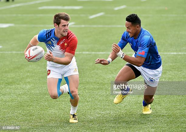 Arthur Retiere of France carries the ball against Ed Fidow of Samoa during the USA Sevens Rugby tournament at Sam Boyd Stadium on March 5 2016 in Las...