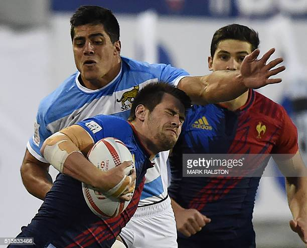 Arthur Retiere of France is tackled by Axel Muller of Argentina during their Men's 2016 USA Sevens Rugby Tournament match at the Sam Boyd Stadium in...