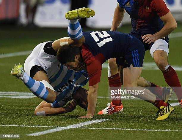 Arthur Retiere of France vies for the ball with Axel Muller of Argentina during their Men's 2016 USA Sevens Rugby Tournament match at the Sam Boyd...