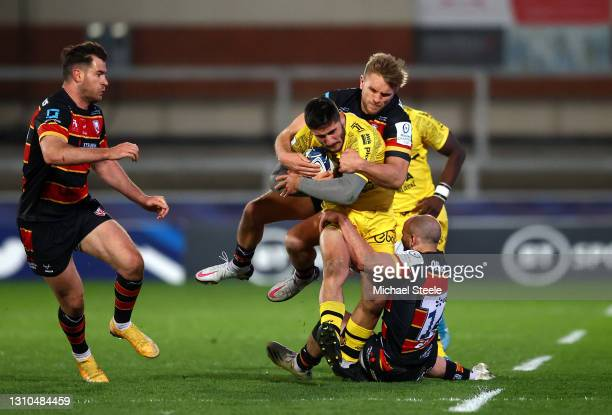 Arthur Retiere of La Rochelle is tackled by Charlie Sharples and Chris Harris of Gloucester during the Heineken Champions Cup Round of 16 match...