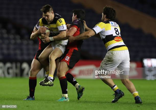 Arthur Retiere of La Rochelle is tackled by Duncan Weir of Edinburgh during The European Challenge Cup match between Edinburgh and La Rochelle at...
