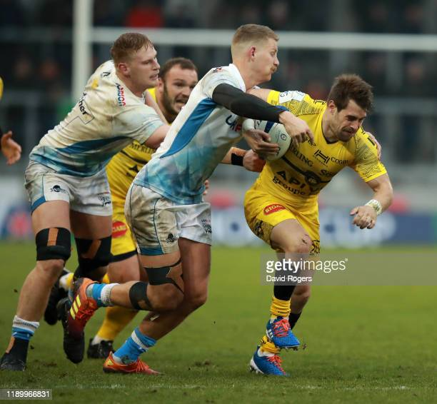 Arthur Retiere of La Rochelle is tackled by Rob du Preez during the Heineken Champions Cup Round 2 match between Sale Sharks and La Rochelle at AJ...