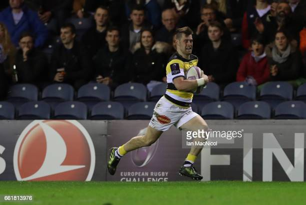 Arthur Retiere of La Rochelle runs in to score his team's third try during The European Challenge Cup match between Edinburgh and La Rochelle at...