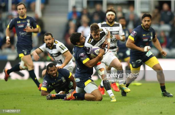 Arthur Retiere of LA Rochelle is tackled by Wesley Fofana of ASM Clermont during the Challenge Cup Final match between La Rochelle and ASM Clermont...