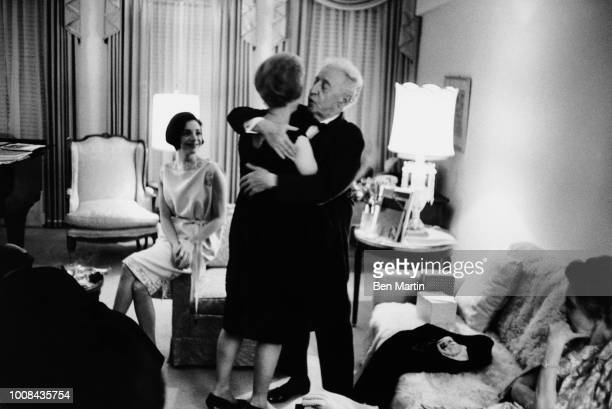 Arthur Rubenstein embracing his wife who has given him a birthday gift