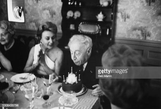 Arthur Rubenstien with Mrs Peabody blowing out candles on his birthday cake