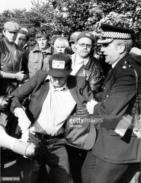 Arthur Scargill the miners leader struggled with the police outside Orgreave coking Plant as he is arrested and led away May 1984