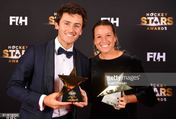 Arthur van Doren of Belgium and Delfina Merino of Argentina hold their awards for player of the year during the Hockey Star Awards night at Stilwerk...