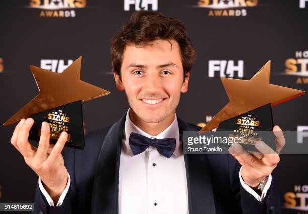 Arthur van Doren of Belgium holds his awards for player of the year and rising star during the Hockey Star Awards night at Stilwerk on February 5...