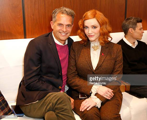 Arthur Wayne and Christina Hendricks attend the Brooks Brothers and St Jude Children's Research Hospital Annual Holiday Celebration at The West...