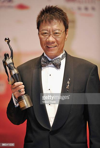 Arthur Wong Ngok Tai poses backstage after winning the Best Cinematography award for his work in Painted Skin during 28th Hong Kong Film Awards 2009...