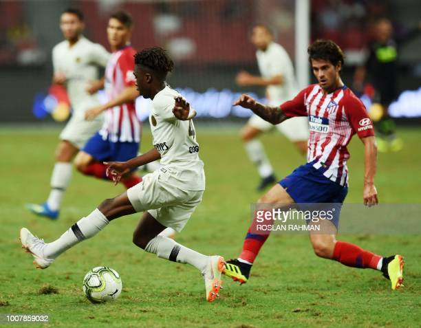 Arthur Zagre of Paris Saint Germain competes against Roberto Olabe of Atletico Madrid during the International Champions Cup football match in...