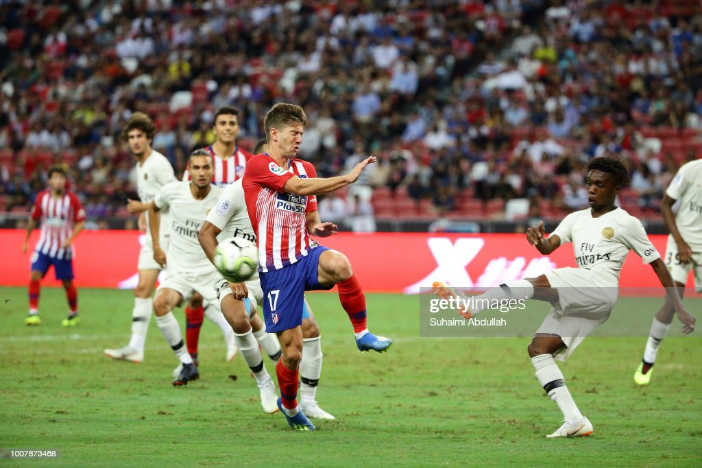 Arthur Zagre of Paris Saint Germain shoots past Luciano Vietto of Atletico Madrid during the International Champions Cup 2018 match between Atletico Madrid and Paris Saint Germain at the National Stadium on July 30, 2018 in Singapore.