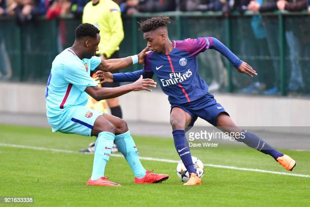 Arthur Zagre of PSG and Ballou Jean Yves Tabla of Barcelona during the UEFA Youth League match between Paris Saint Germain and FC Barcelona on...