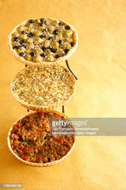 Artichoke and Olive tart Corn and Roasted Red Peppers tart and Ratatouille tart Food styled by Cindy Lee and Audrey Sherman in San Francisco Calif on...