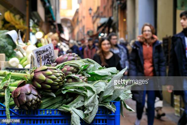 artichokes at market stall, bologna, italy - bologna stock pictures, royalty-free photos & images