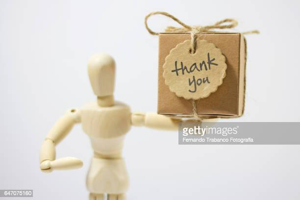 Articulated doll delivers a thank you gift box