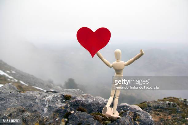Articulated doll with a red heart (in love)