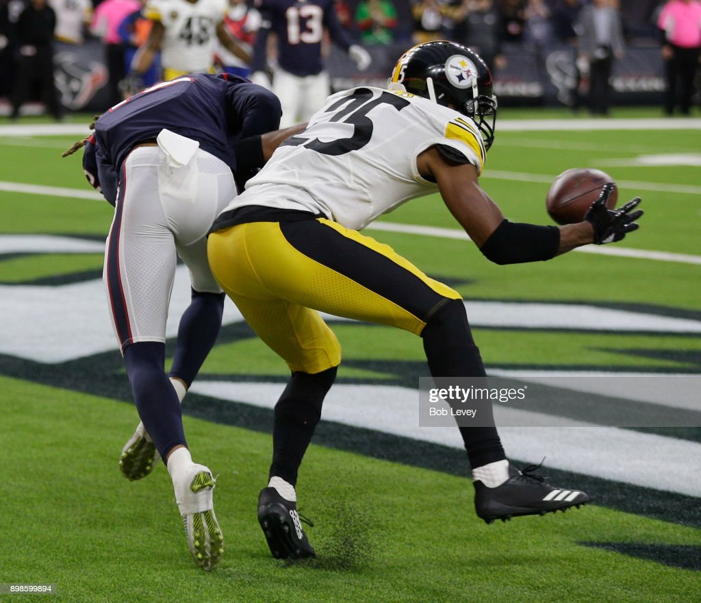 Artie Burns #25 of the Pittsburgh Steelers intercepts a pass intended for Will Fuller V #15 of the Houston Texans in the second quarter at NRG Stadium on December 25, 2017 in Houston, Texas.