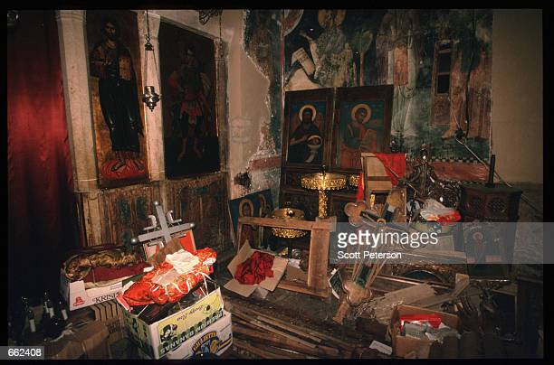 Artifacts from various bombed churches are stored in a Church August 16 1999 in Pec Kosovo Yugoslavia Kosovo Peacekeeping Force soldiers fail to...