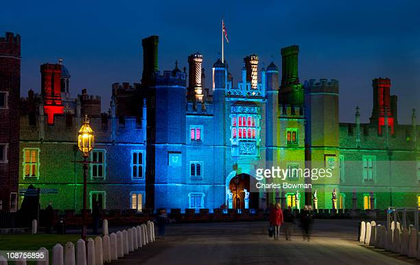 artifical lights illuminate hampton court palace - hampton court stock pictures, royalty-free photos & images