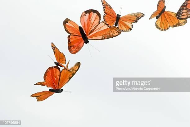 Artificial butterflies flying