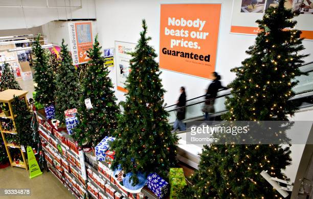 artificial christmas trees sit on display inside a home depot store in new york us on
