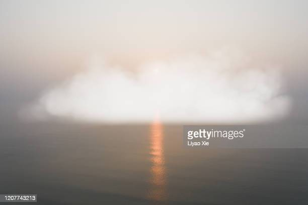 artificial clouds on the sea - liyao xie stock pictures, royalty-free photos & images