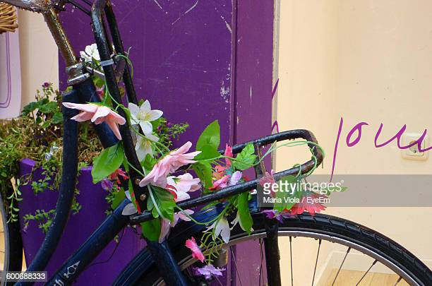 Artificial Flowers On Bicycle Outside House