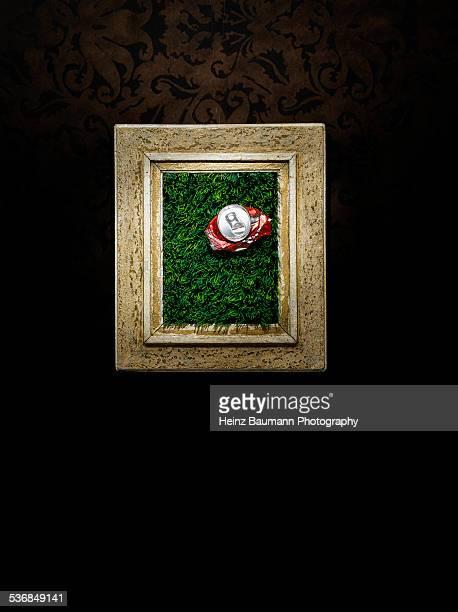 artificial grass and crushed soda can - heinz baumann photography stock-fotos und bilder