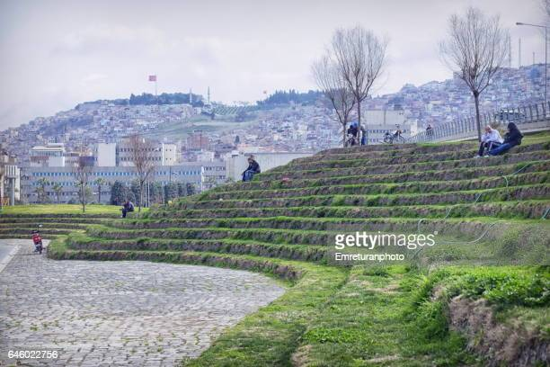artificial grass terrace in konak square,izmir - emreturanphoto stock pictures, royalty-free photos & images