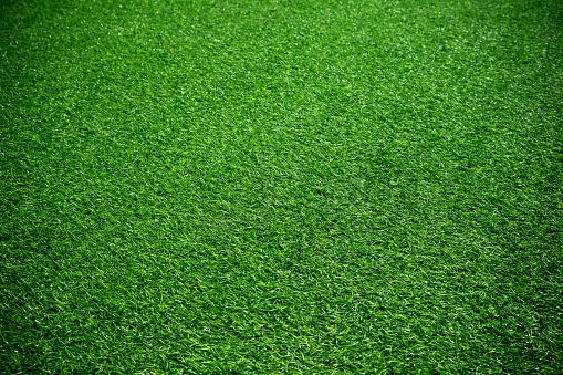 Artificial green grass textured background 947315674
