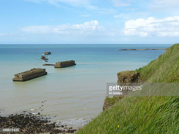 artificial harbour (world war ii) - arromanches stock pictures, royalty-free photos & images