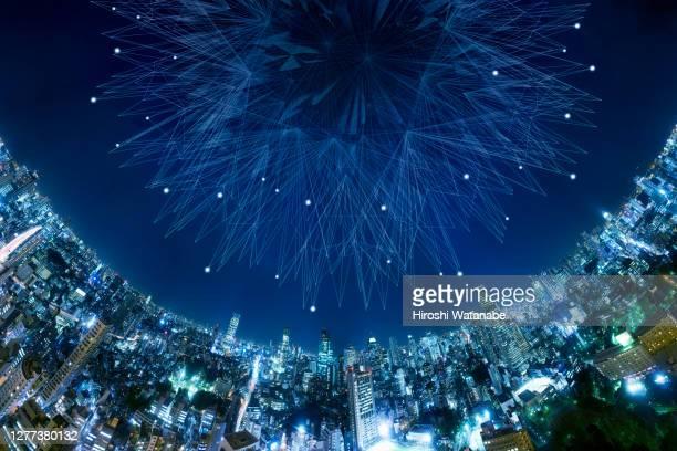 artificial intelligence above the city night view - gemak stockfoto's en -beelden