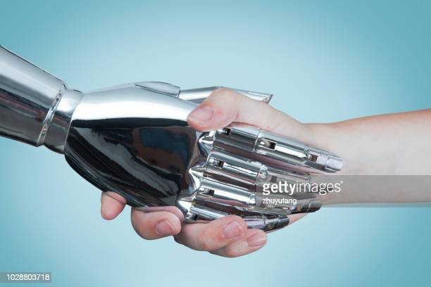artificial intelligence concept - human arm stock pictures, royalty-free photos & images
