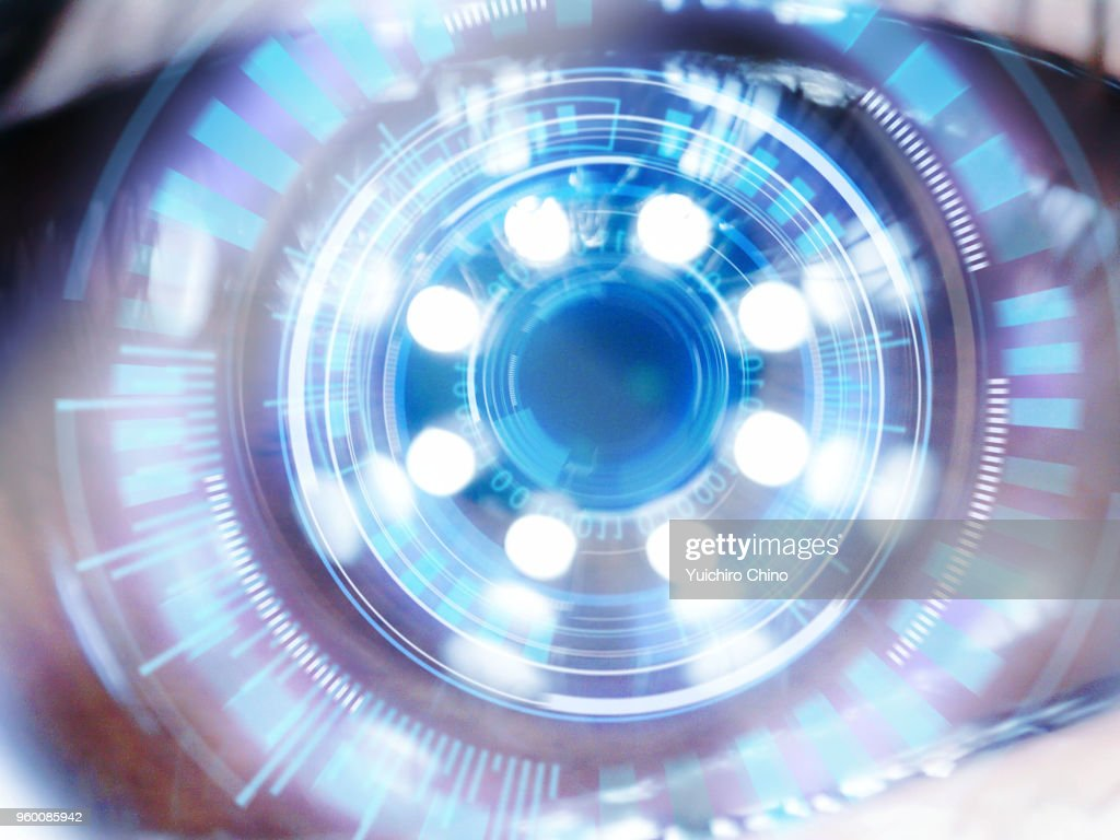 Artificial intelligence digital screen over the eye : Stock Photo