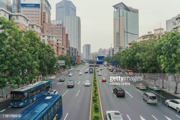 artificial intelligence of deep learning in city main road - deep learning stock pictures, royalty-free photos & images