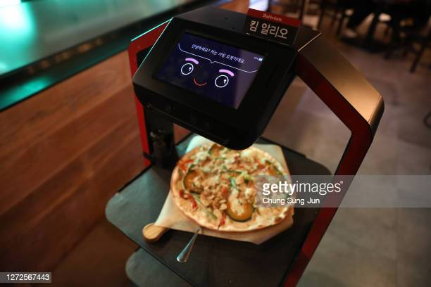 Artificial intelligence serving robot delivers meal during a demonstration at a restaurant on September 15, 2020 in Seoul, South Korea. KT launched a...