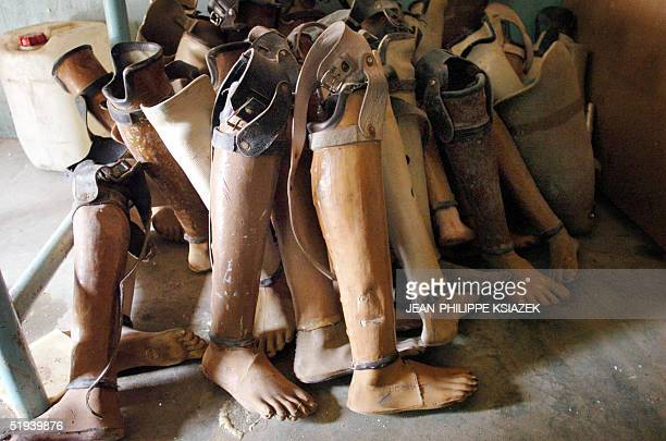 Artificial limbs await custormer in a workshop in Kilinochchi an area controlled by the Tamil Tigers in northern Sri Lanka 12 January 2005 The...