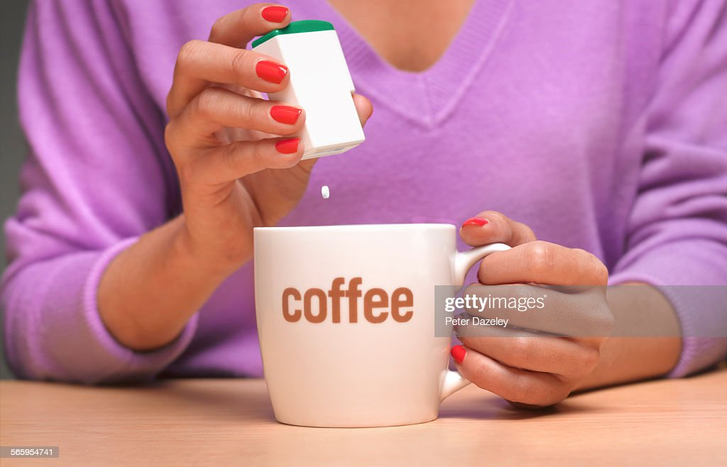 Artificial sweetener in coffee : Stock Photo