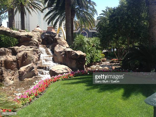 Artificial Waterfall In Garden At City