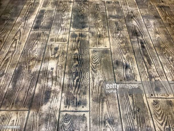 artificial wood grain pattern on cement floor - november background stock photos and pictures