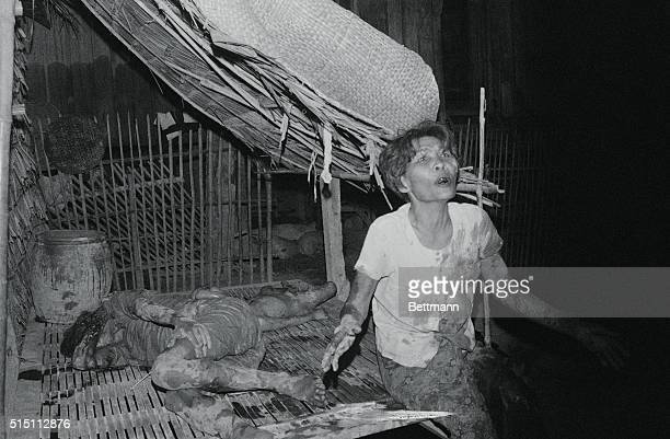 Artillery Attack Victims Phnom Penh Covered with blood a woman screams for help as her husband and child lie wounded and bleeding following a Khmer...