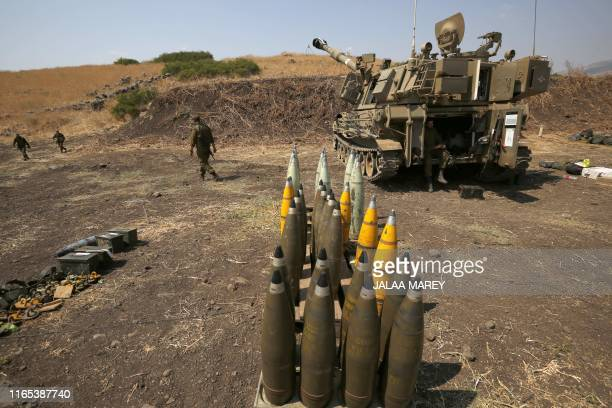 TOPSHOT Artillery shells are lined up beside an Israeli selfpropelled artillery gun near the Lebanese border on the outskirts of the northern Israeli...