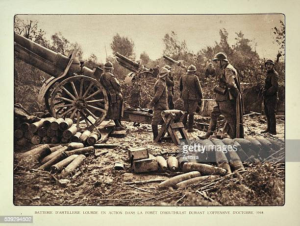 Artillery soldiers firing battery cannons from forest at Houthulst in Flanders during the First World War Belgium