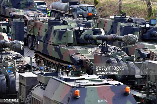 M109 artillery tanks of the US Army stand by at the Bergen Hohne training facility as part of preparations for the Defender 2020 international...