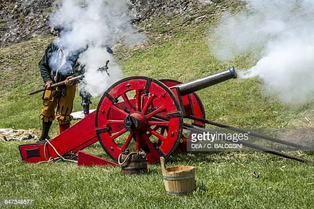 Artilleryman firing a cannon mercenary army Italy 16th century Historical reenactment