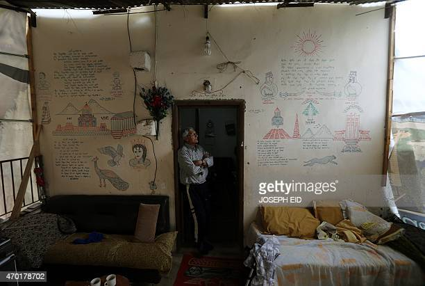 Artin Arslenian a 74 year old Syrian Armenian who fled the violence in Aleppo stands at the entrance of his house on April 17 in the historic town of...